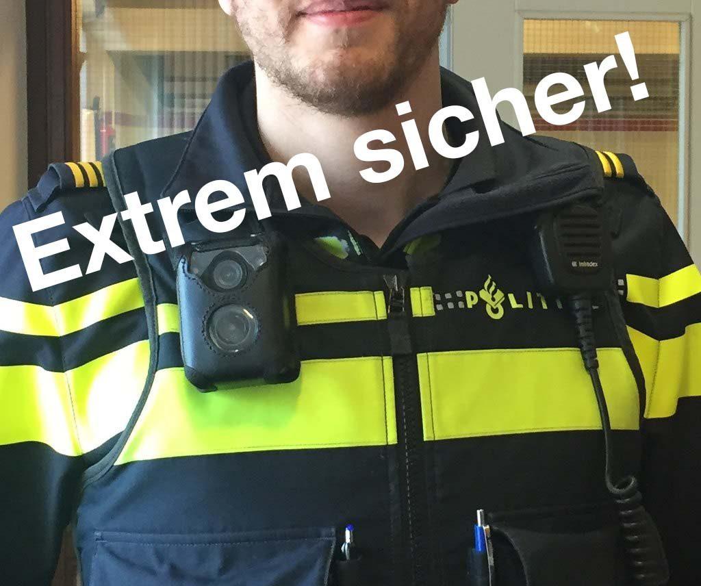 Polizist mit Bodycam, Schrift auf Bild: Extrem sicher!